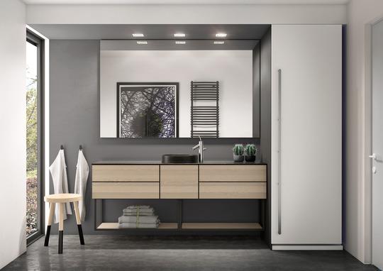 Svane Køkkenet i Aars: Grafiske elementer og greb indtager badeværelset